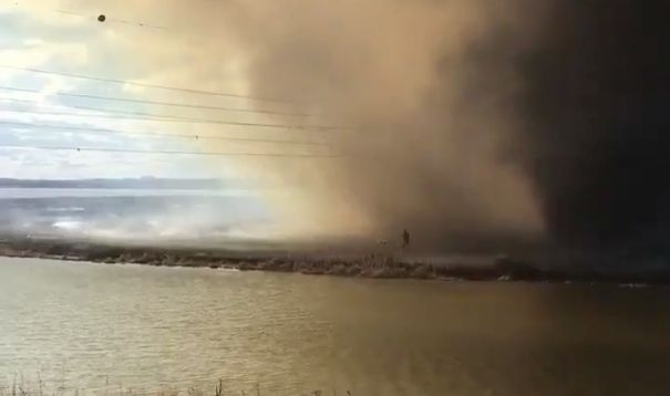 Firefighter Captures Terrifying Moment Colleague Leaps Into Lake To Escape A Fire