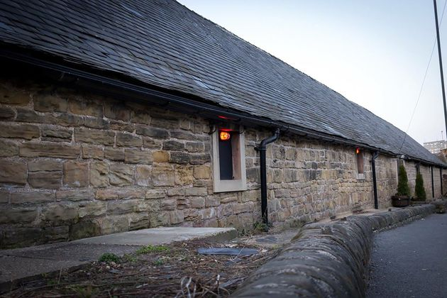 The vigil was held in a 19th century building based where an old barn once