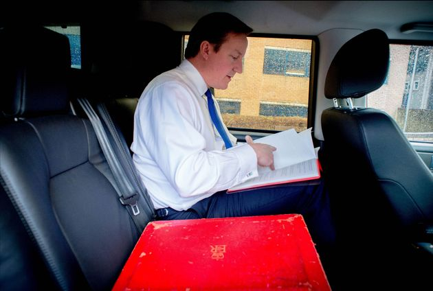 David Cameron pictured in his ministerial car with