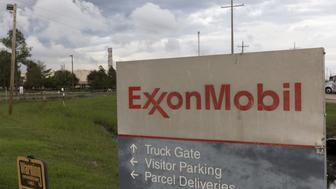 A sign is seen at the entrance of the Exxonmobil Port Allen Lubricants Plant in Port Allen, Louisiana, November 6, 2015. A near century-old statute that gives New York state prosecutors unusually broad authority to prosecute securities fraud could prove a powerful weapon as Attorney General Eric Schneiderman probes Exxon Mobil Corp over whether the oil firm misled the public and shareholders about the perils of climate change. REUTERS/Lee Celano