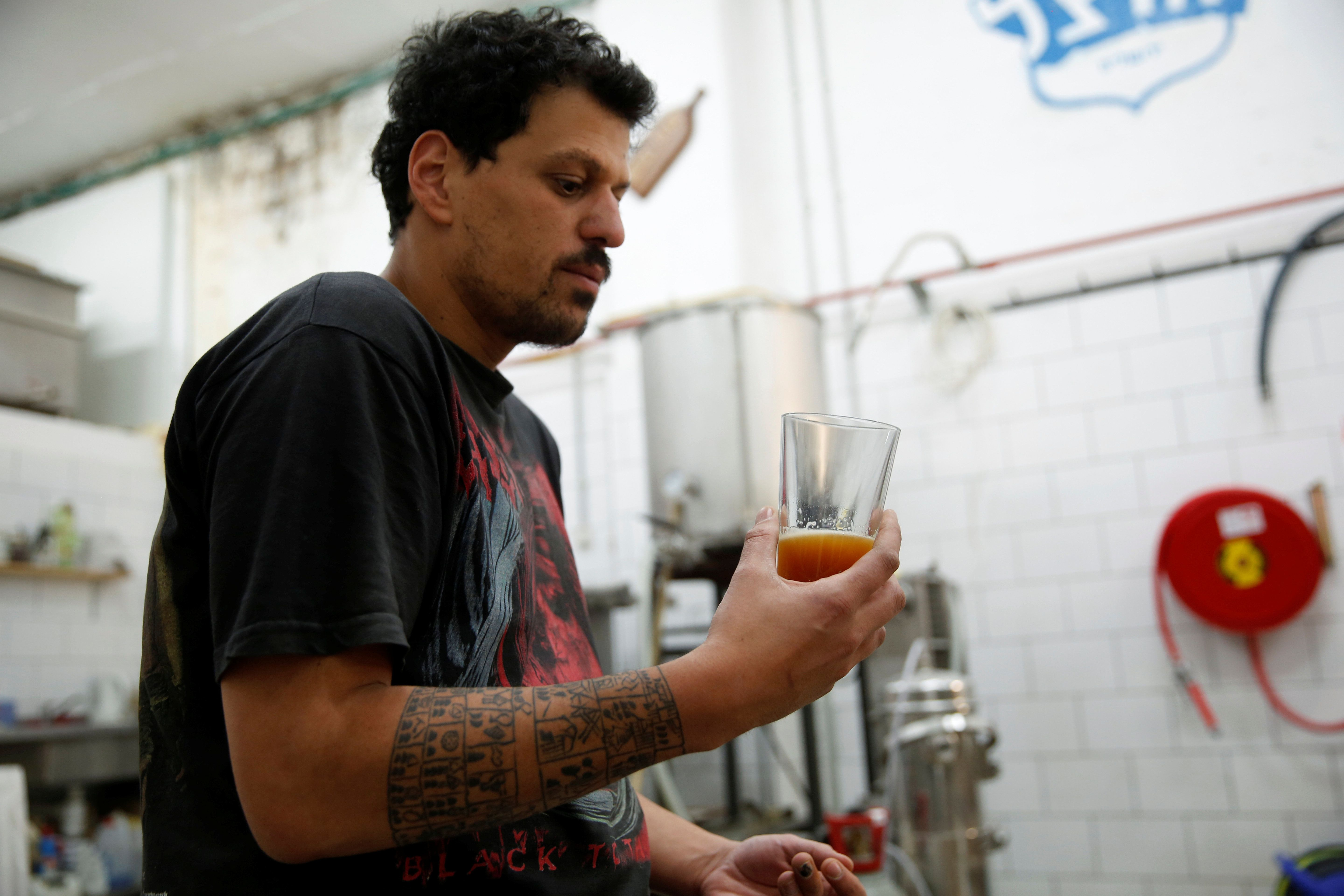 Itai Gutman, owner of Herzl Brewery which produced a craft beer from wheat that Tel Aviv University geneticists identified as the strain used for beer in the Holy Land two millennia ago, works at the brewery in Jerusalem April 18, 2016. REUTERS/Ronen Zvulun