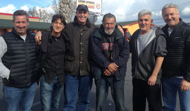 The Waldos pose with Newman, third from the right, outside a motel in San