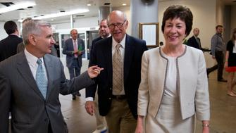 UNITED STATES - JULY 10:  From left, Sens. Jack Reed, D-R.I., Pat Roberts, R-Kan., and Sue Collins, R-Me., make their way through the basement of the Capitol before the senate luncheons.  (Photo By Tom Williams/CQ Roll Call)