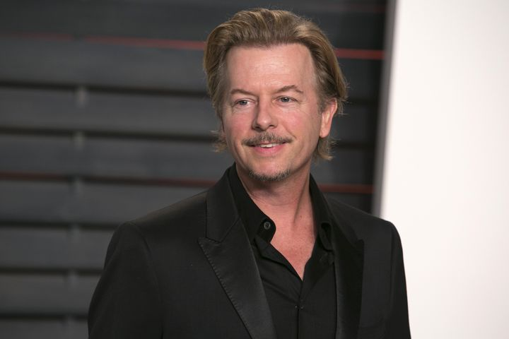 US actor and producer David Spade poses as he arrives to the 2016 Vanity Fair Oscar Party in Beverly Hills, California on Feb