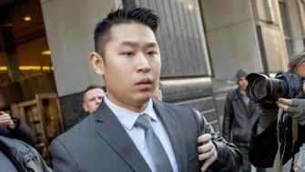 New York City Police (NYPD) officer Peter Liang (C) departs the criminal court after an arraignment hearing in the Brooklyn borough of New York City February 11, 2015. The New York City rookie police officer was charged with manslaughter in the second degree and five other offenses on Wednesday for the fatal shooting of an unarmed man in the darkened stairwell of a housing project last November. REUTERS/Brendan MCDermid (UNITED STATES - Tags: CRIME LAW)