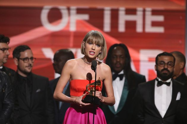 Taylor Swift accepts a Grammy for Best Album on Feb. 15,