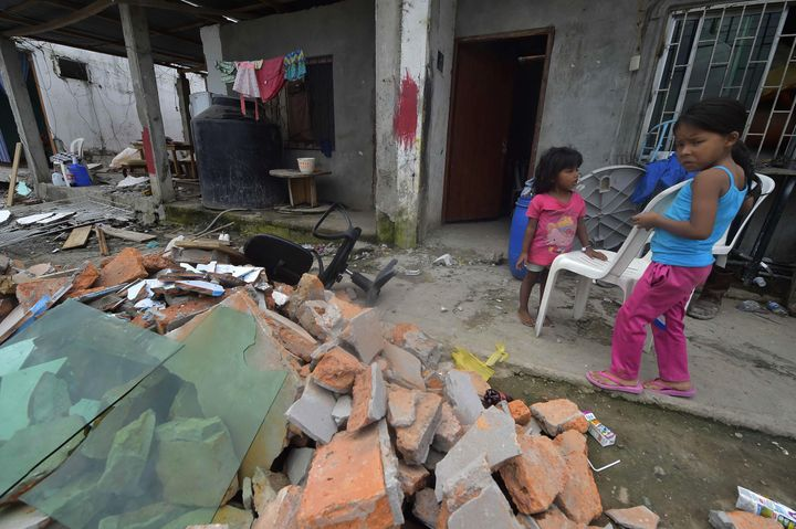 Children are seen at the rubble in one of Ecuador's worst-hit towns, Pedernales, a day after a 7.8-magnitude quake hit the co