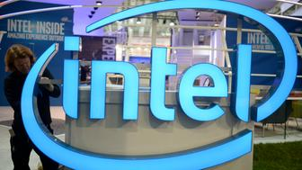 A worker arranges an Intel logo at the CeBIT trade fair, the world's biggest computer and software fair, in Hannover March 13, 2016.  REUTERS/Nigel Treblin