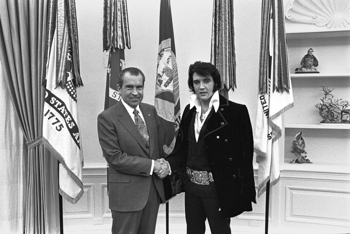 President Nixon shakes hands with Elvis Presley in the Oval Office in Washington, DC in December 1970 after the little-known