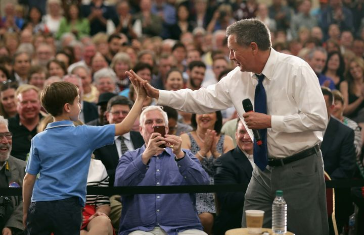 Kasich high-fives a boy who joined him on stage during a town hall meeting in Annapolis, Maryland, this week.