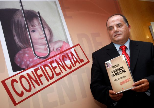 Former detective Goncalo Amaral poses with his book in