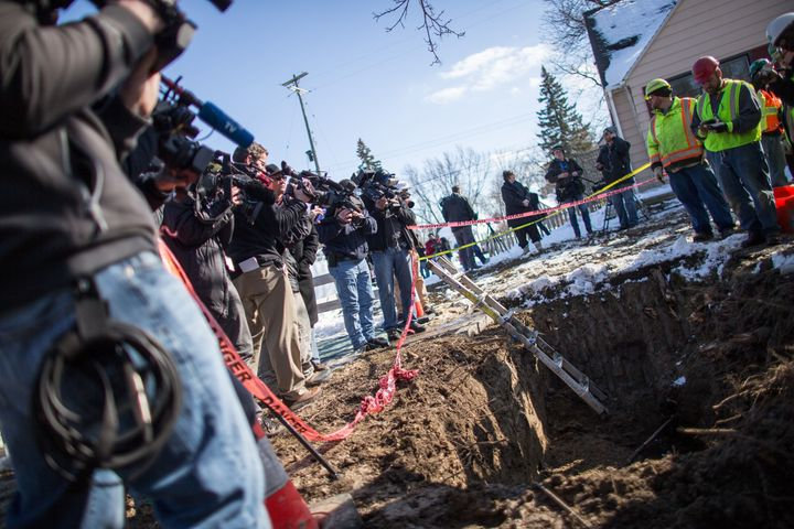 Workers replace an old lead pipe with a new safer copper pipe at a home in Flint, Michigan, March 4, 2016.
