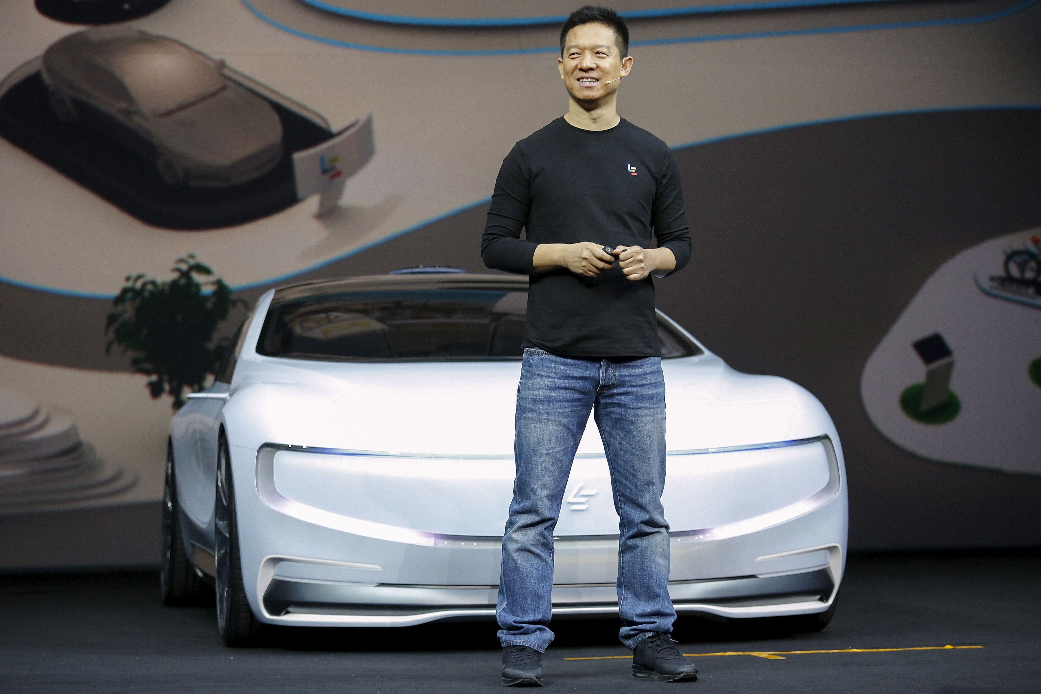 """Jia Yueting, co-founder and head of Le Holdings Co Ltd, also known as LeEco and formerly as LeTV, unveils an all-electric battery """"concept"""" car called LeSEE during a ceremony in Beijing, China April 20, 2016. REUTERS/Damir Sagolj"""