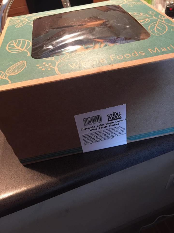 Video and photos of the cake shows the box's white label on its side, not on the top, suggesting that Brown opened the box an