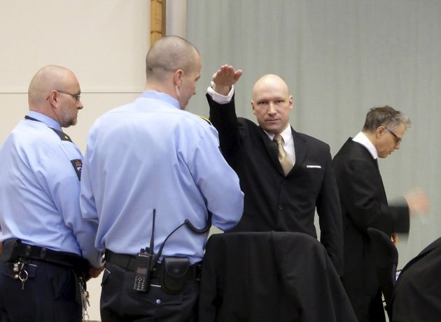 Mass killer Anders Behring Breivik raises his arm in a Nazi salute in court on 15 March