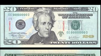 Image shows the new $20 bill, which was unveiled at the Bureau of Engraving and Printing in Washington May 13, 2003. The new bill has enhanced security features and subtle background colors as part of an ongoing effort to stay ahead of the counterfeiting of U.S. currency. The new bill will be issued this autumn.    (Credit : REUTERS/HO/Bureau of Engraving and Printing) ??? USE ONLY