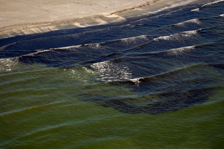 Oil from the Deepwater Horizon spill is visible in the surf off Fourchon Beach, Louisiana July 9, 2010.