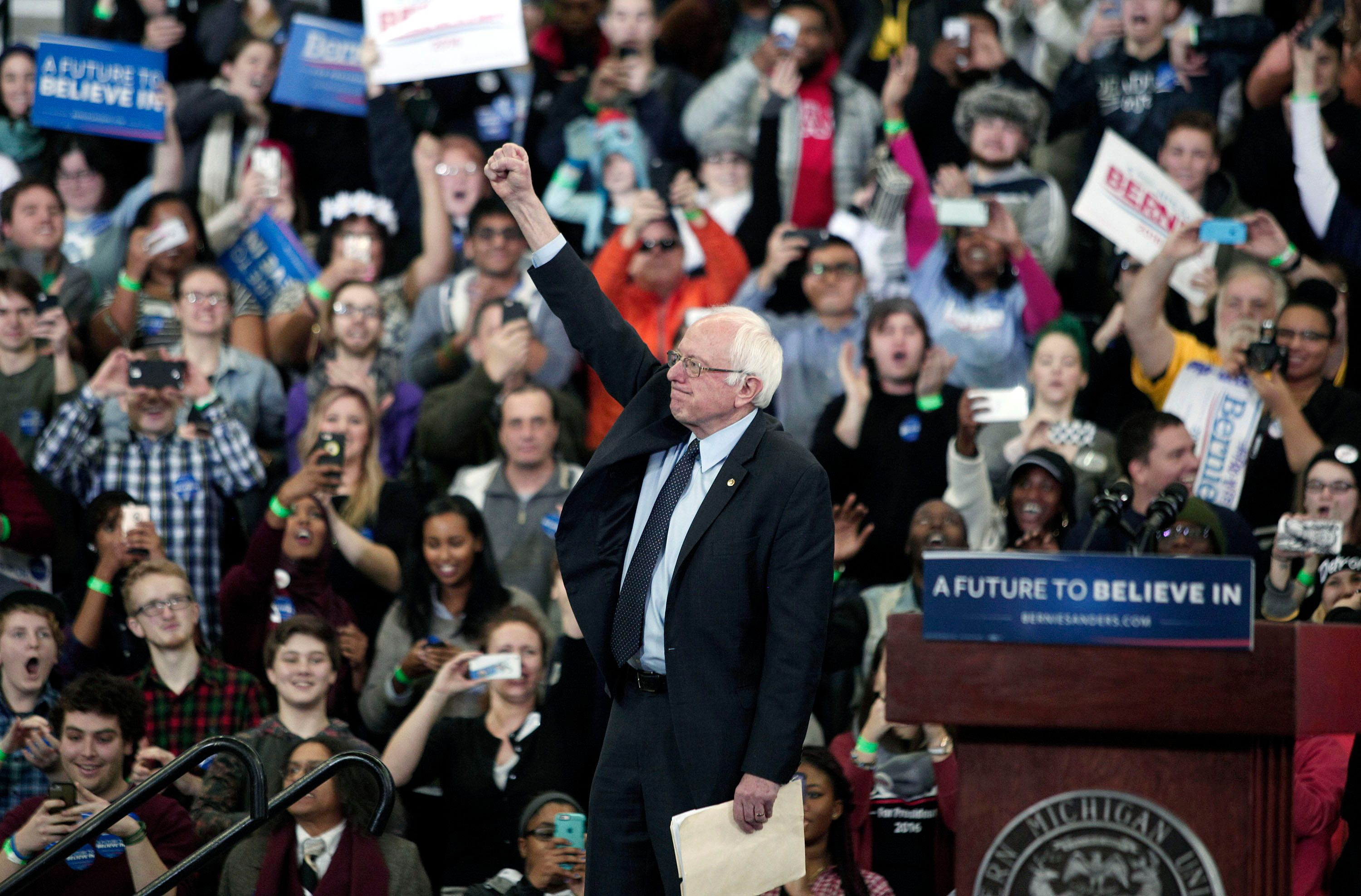 YPSILANTI, MI - FEBRUARY 15:  Democratic presidential candidate Sen. Bernie Sanders (D-VT) gestures during his first campaign rally in Michigan at Eastern Michigan University February 15, 2016 in Ypsilanti, Michigan. At his 'A Future To Believe In' rally, Sanders spoke on a wide range of issues, including his plans to make public colleges and universities tuition-free.  The next voting for the democratic candidates will be the Democratic caucus in Nevada on February 20th. (Photo by Bill Pugliano/Getty Images)