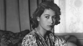 30th May 1944:  Queen Elizabeth II (as Princess Elizabeth) writing at her desk in Windsor Castle, Berkshire.  (Photo by Lisa Sheridan/Studio Lisa/Getty Images)