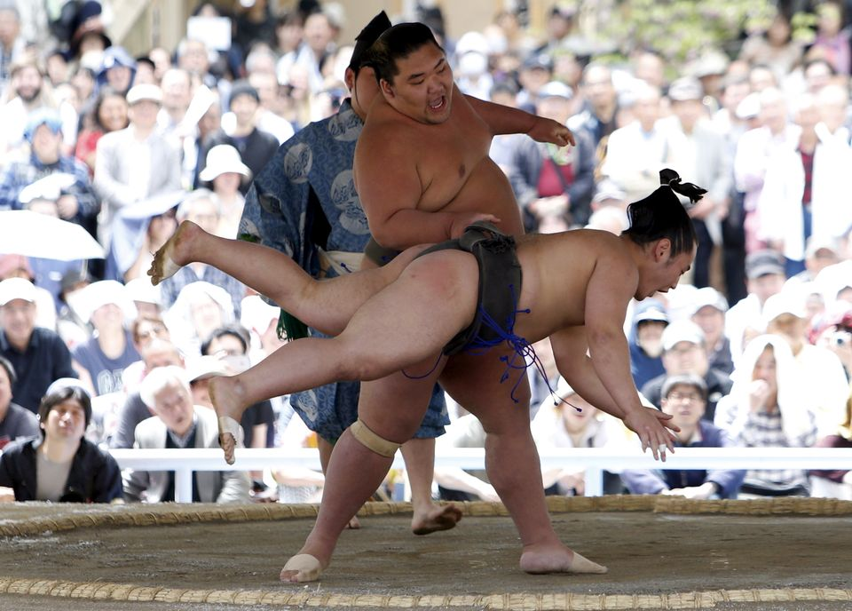 The annual 'Honozumo' ceremonial Spring Festival sumo tournament  was held outdoors at a controversial war shrine in the