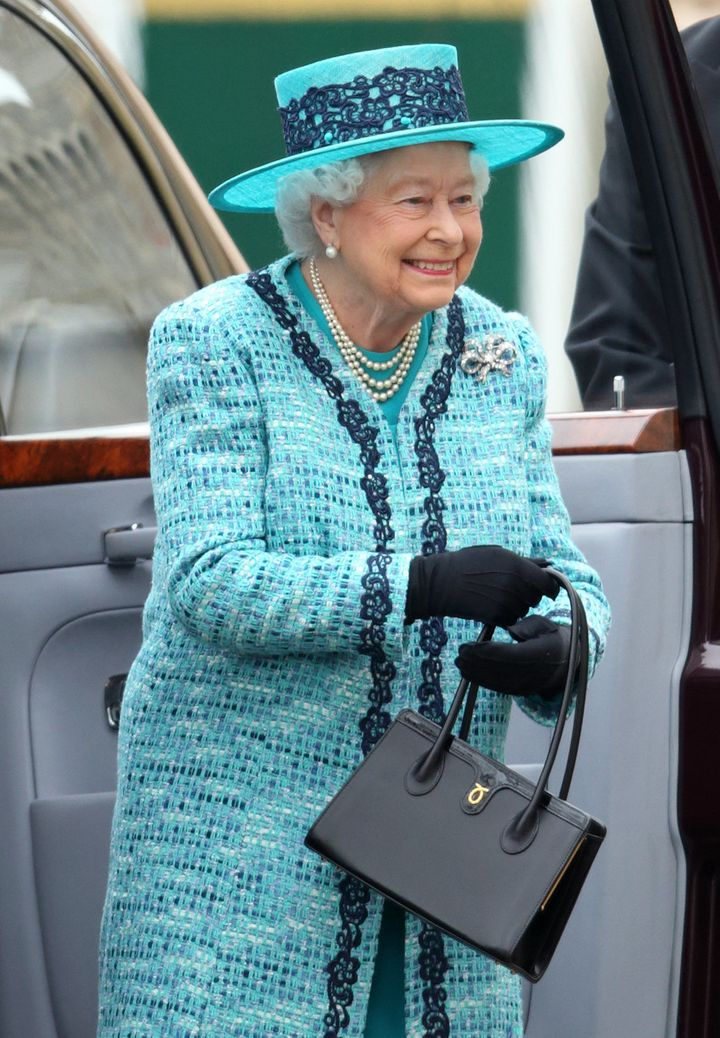Queen Elizabeth II attends the traditional Royal Maundy Service at St George's Chapel, Windsor Castle on March 24, 2016 in Windsor, England.