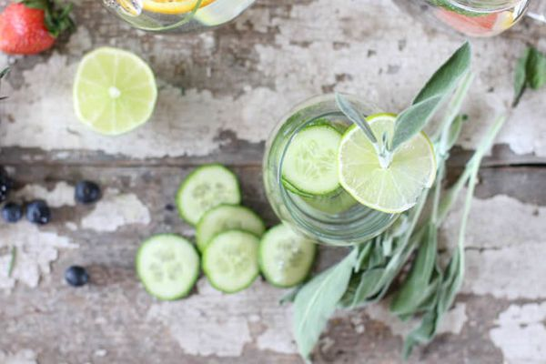 """Get the <a href=""""http://nutritionstripped.com/simply-infused-water/"""" target=""""_blank"""">Cucumber, Lemon, Lime, Mint & Basil"""