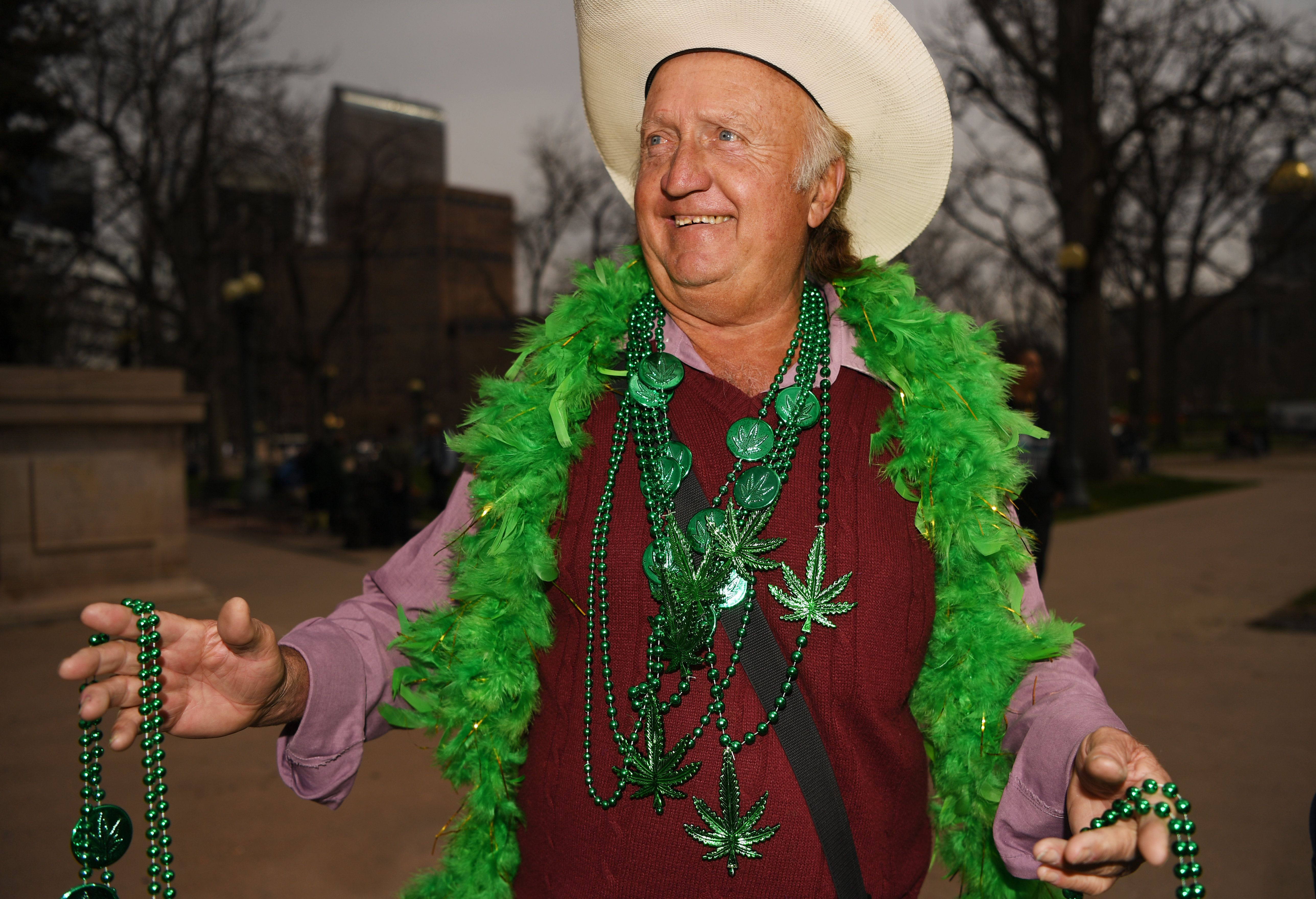 DENVER, CO - APRIL 20: Jerry Ludke sells weed necklaces during the 420 celebration at Civic Center Park in Denver, April 20, 2016. People gather at the park to celebrate marijuana. (Photo by RJ Sangosti/The Denver Post via Getty Images)