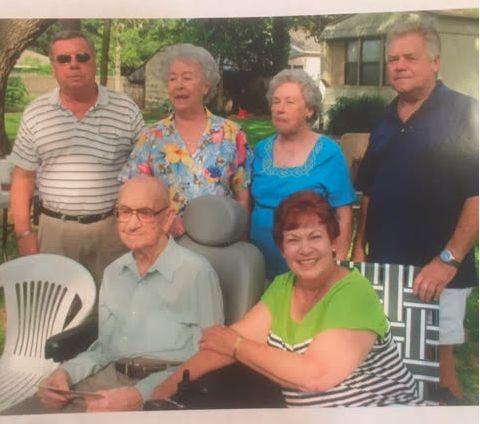 A recent family photo of Felix Simoneaux Jr. with his five surviving children.