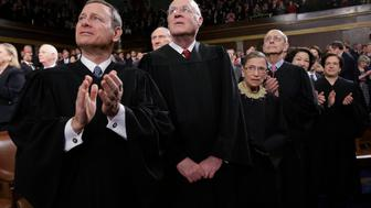 U.S. Supreme Court Justices Chief Justice John Roberts, Anthony Kennedy, Ruth Bader Ginsburg, Stephen Breyer, Sonia Sotomayor and Elena Kagan (L-R) applaud prior to President Obama's State of the Union speech on Capitol Hill in Washington, February 12, 2013. REUTERS/Charles Dharapak/Pool (UNITED STATES - Tags: POLITICS)