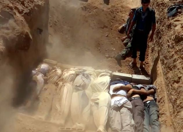 The activists say the mass graves may be the result of atrocities carried out by ISIS as well as by government...