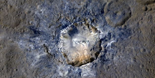 An enhanced color view of theHaulani Crater on Ceres taken byNASA's Dawn spacecraft from...