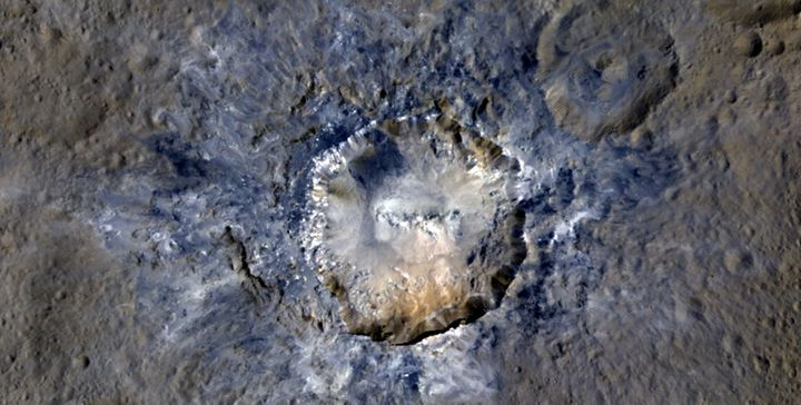 An enhanced color view of theHaulani Crater on Ceres taken byNASA's Dawn spacecraft from a distance of 915 miles.
