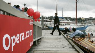 Jon S. von Tezchner, CEO of Opera Software ASA, walks off a boat Tuesday, June 20, 2006, as he arrives at the official launch of the Opera 9 Internet Browser in Seattle at a restaurant on Lake Union. Tetzchner came to Seattle from Norway to launch the new Opera browser near Microsoft Corp.'s headquarters in Redmond, Wash., as Microsoft is expected to release an overhauled version of it's Internet Explorer browser later this year. (AP Photo/Ted S. Warren)