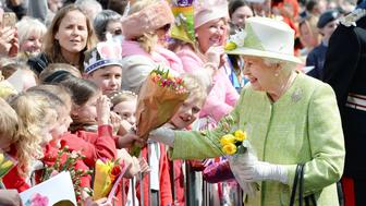 Britain's Queen Elizabeth II greets wellwishers during a 'walkabout' on her 90th birthday in Windsor, west of London, on April 21, 2016. Britain celebrates Queen Elizabeth II's 90th birthday on Thursday, with her eldest son Prince Charles paying tribute in a special radio broadcast and Prime Minister David Cameron leading a parliamentary homage. / AFP / POOL / John Stillwell        (Photo credit should read JOHN STILLWELL/AFP/Getty Images)