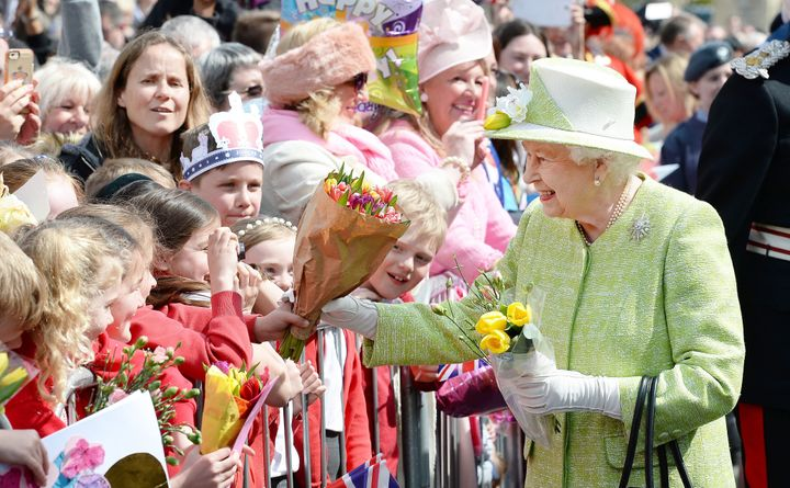Britain's Queen Elizabeth II greeted thousands of well-wishers as she celebrated her 90th birthday during a lengthy walkabout
