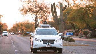Test drivers use a Lexus SUV, built as a self-driving car, to map the area prior to a journey without a driver in control, in Phoenix, Arizona April 5, 2016 in a photo provided by Google. Alphabet Inc is expanding its testing of self-driving cars to the Phoenix, Arizona metro area, the company said on Thursday, making it the fourth U.S. city to serve as a proving ground for the autonomous vehicles.  REUTERS/Google/Handout via Reuters       ATTENTION EDITORS - THIS PICTURE WAS PROVIDED BY A THIRD PARTY. REUTERS IS UNABLE TO INDEPENDENTLY VERIFY THE AUTHENTICITY, CONTENT, LOCATION OR DATE OF THIS IMAGE. EDITORIAL USE ONLY. NOT FOR SALE FOR MARKETING OR ADVERTISING CAMPAIGNS. NO RESALES. NO ARCHIVE. THIS PICTURE IS DISTRIBUTED EXACTLY AS RECEIVED BY REUTERS, AS A SERVICE TO CLIENTS