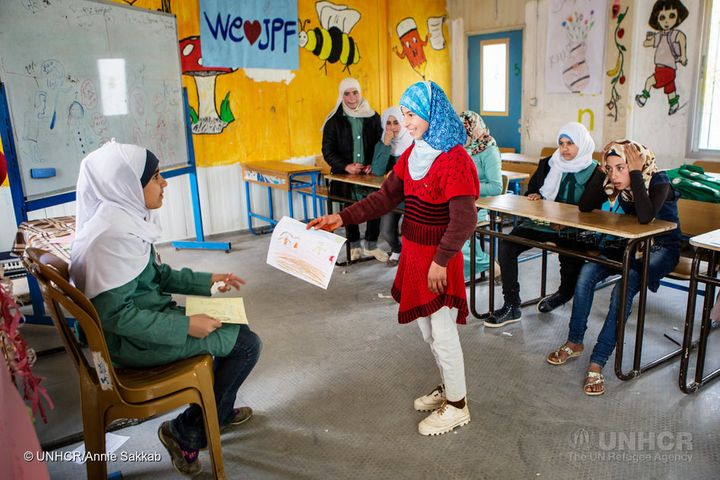 15-year-old Syrian refugee Omaima at a drawing class she teaches to raise awareness of the dangers of early marriage at Za'at