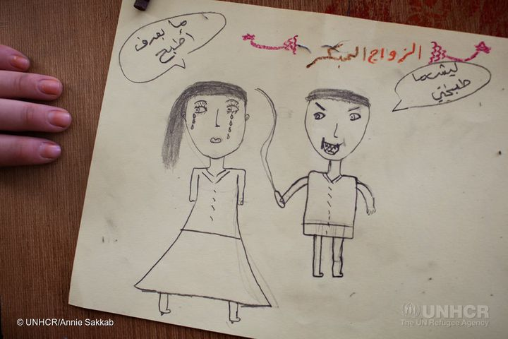 A teenage girl drawing a husband hitting his teenage wife for not being able to cook, at a drawing class Omaima teaches at Za