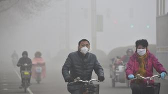 LIAOCHENG, CHINA - FEBRUARY 12:  (CHINA OUT) Citizens ride in the heavy smog on February 12, 2015 in Liaocheng, Shandong Province of China. Chinese people exploded firecrackers during the lunar new year holiday which made the air quality bad in some parts of China.  (Photo by ChinaFotoPress/ChinaFotoPress via Getty Images)