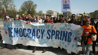 WASHINGTON, DC - APRIL 11: Democracy Spring protesters march to the U.S. Capitol to protest big money in politics, April 11, 2016 in Washington, DC. More than 2,000 people have pledged to participate in the organization's sit-ins to 'save democracy' following a 10-day march from the Liberty Bell in Philadelphia to the steps of the U.S. Capitol. (Photo by Mark Wilson/Getty Images)