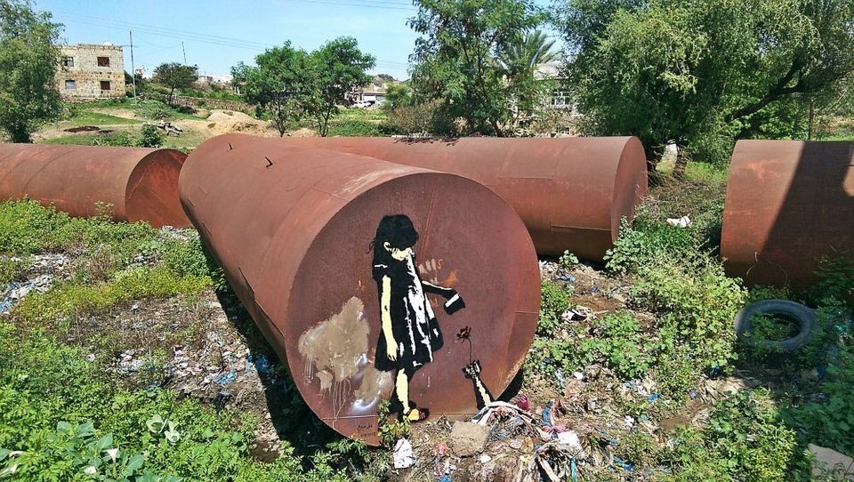 Yemeni Street Artist Covers The Ruins Of War In Color And