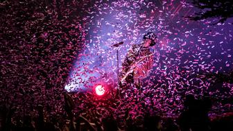 Singer and musician Prince plays a guitar solo while confetti (of course coloured purple) is flying around over the concert crowd at his gig at Skanderborg Festival. Denmark 2013.. (Photo by: PYMCA/UIG via Getty Images)