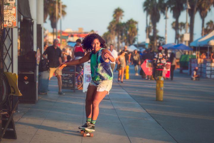 Skateboarding on the Venice Beach boardwalk.