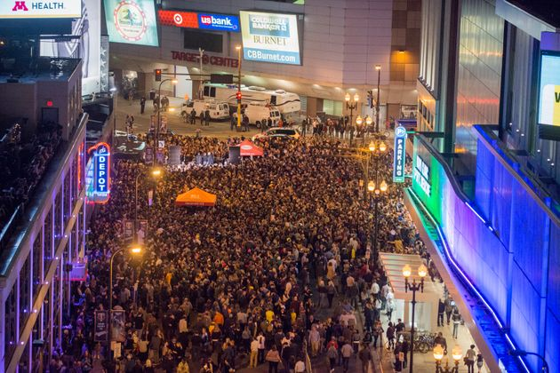 Fans gathered in the street outside the night spot, where he filmed the 'Purple Rain'
