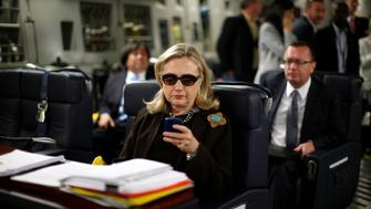 U.S. Secretary of State Hillary Clinton checks her PDA upon her departure in a military C-17 plane from Malta bound for Tripoli,  Libya October 18, 2011.  REUTERS/Kevin Lamarque  (LIBYA - Tags: POLITICS)         FOR BEST QUALITY IMAGE ALSO SEE: GF2EA1P10ZY01