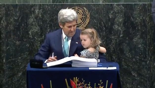 Secretary of State John Kerry signed the Paris agreement with his granddaughter in his arms.