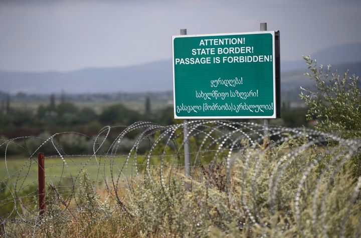 A warning sign placed along the border Russia has enforced between Georgia and South Ossetia.