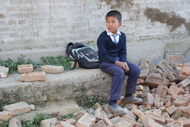 A boy sits in the rubble of a school in Bhaktapur, Nepal. Global children's charity Theirworld released a video this week tha