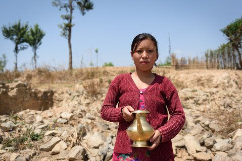 Prapti Tamang lost her house in the earthquake and now lives in a corrugated metal home that cost about 20,000 Nepalese rupee