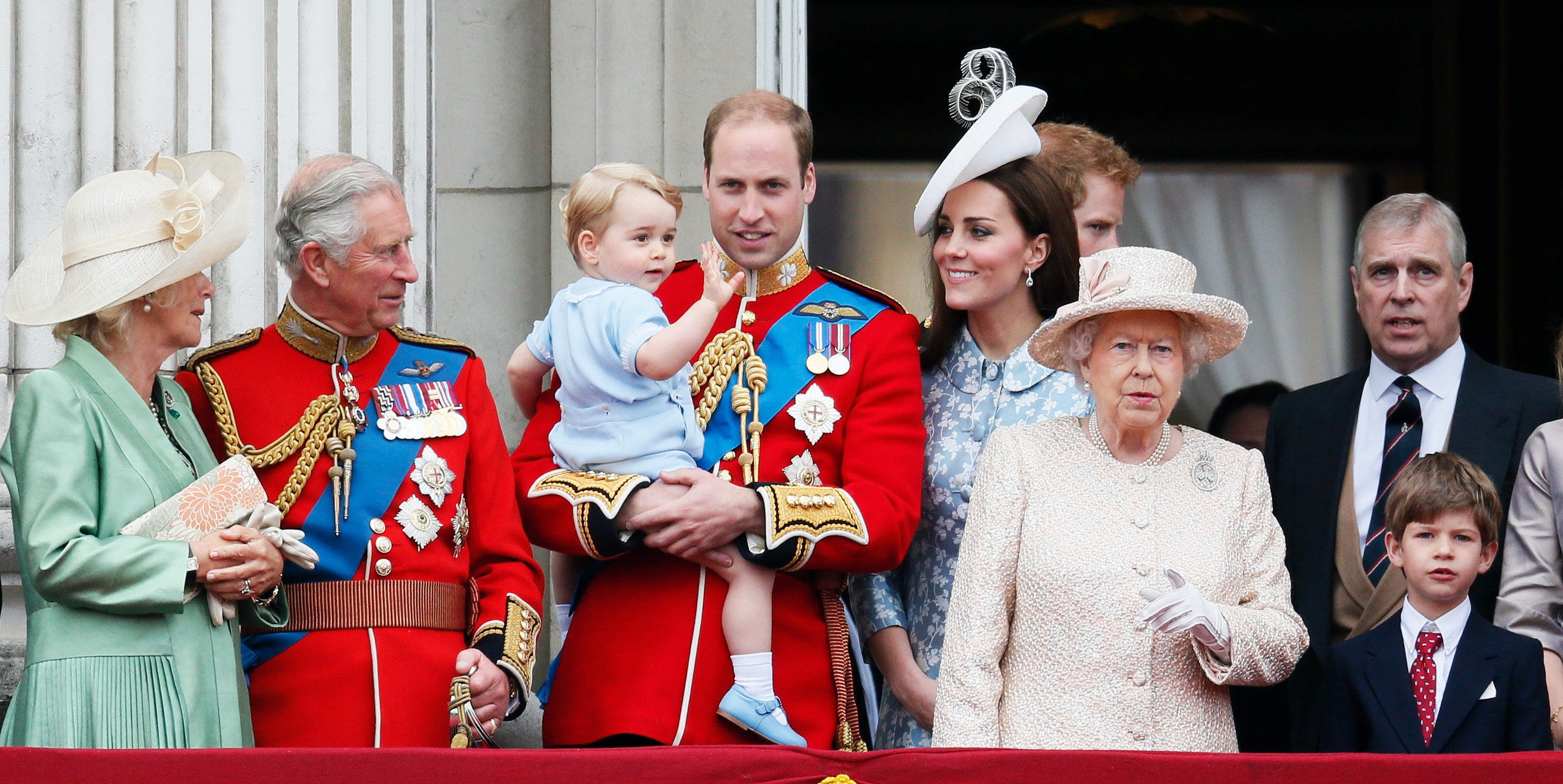 Britain's (L-R) Camilla The Duchess of Cornwall, Prince Charles, Prince Willian holding Prince George, Catherine, the Duchess of Cambridge, Queen Elizabeth, and Prince Andrew stand on the balcony at Buckingham Palace after attending the Trooping the Colour ceremony at Horse Guards Parade in central London, Britain June 13, 2015. Trooping the Colour is a ceremony to honour the Queen's official birthday.   REUTERS/Stefan Wermuth TPX IMAGES OF THE DAY
